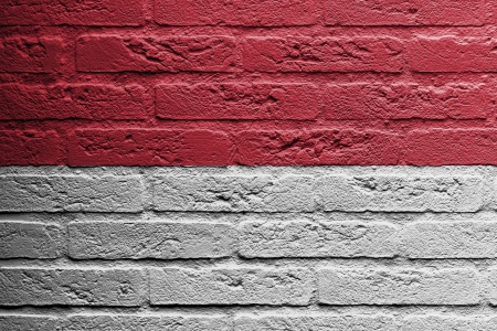 Brick wall with a painting of a flag isolated, Indonesia photo
