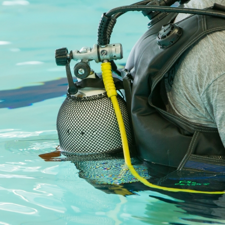 Close-up of a scuba diver, yellow storage tank Stock Photo - 18383128
