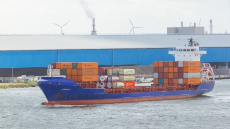 containership: ROTTERDAM, THE NETHERLANDS - JUNE 22: Close-up of a containership, operated by a privately-owned company engaged in worldwide container transport in Rotterdam on June 22, 2012