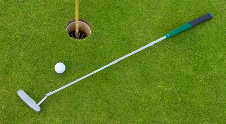 golf hole: Golf hole with ball and putt (Holland) Stock Photo