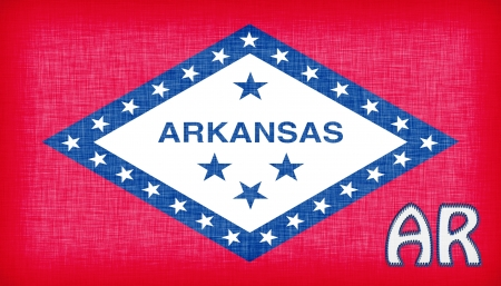 Linen flag of the US state of Arkansas with its abbreviation stitched on it Stock Photo