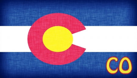 denver: Linen flag of the US state of Colorado with its abbreviation stitched on it Stock Photo