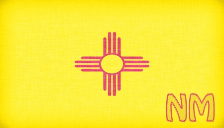 nm: Linen flag of the US state of New Mexico with its abbreviation stitched on it