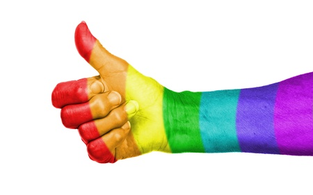 Old woman with arthritis giving the thumbs up sign, rainbow flag pattern Standard-Bild