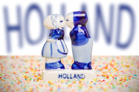 Typical dutch delft blue ceramic, standing on candy photo