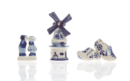 Typical dutch souvenirs on a row, isolated on white photo