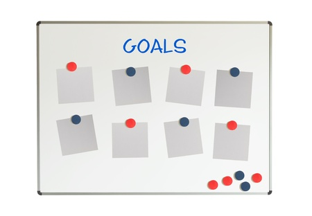 Goals on a whiteboard, isolated on a white background photo