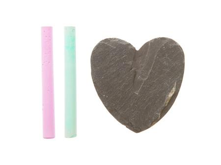 Heart shaped piece of slate over white photo