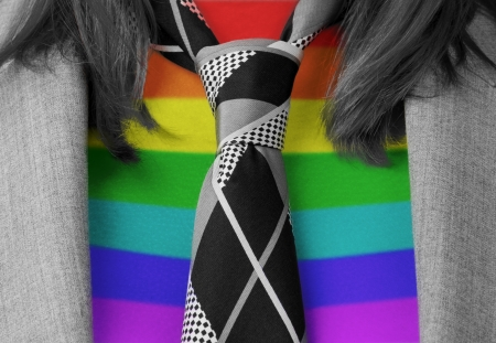 Close-up of a caucasian business woman with a tie,rainbow flag pattern photo