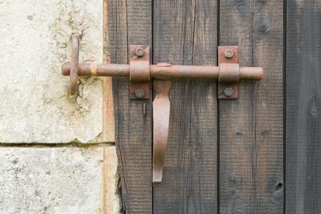 Wrought iron lock old wooden door, portrait photo