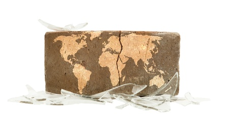 Brick with broken glass, violence concept, world map photo