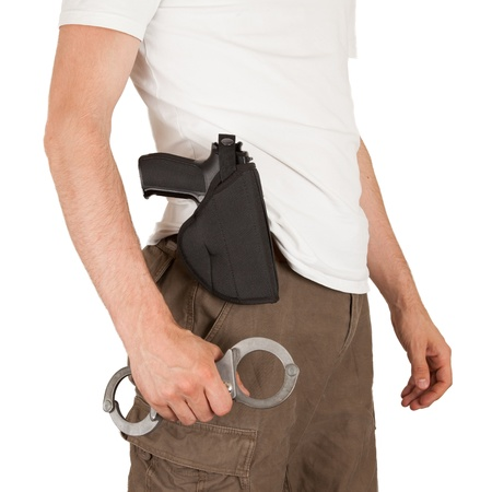 law enforcer: Close-up of a man with a gun and handcuffs, isolated on white