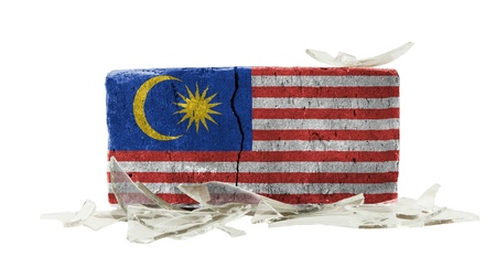 Brick with broken glass, violence concept, flag of Malaysia photo