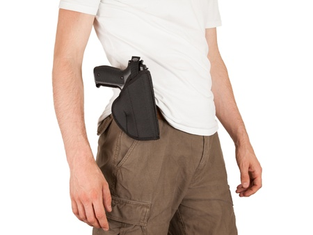 law enforcer: Close-up of a man with holster and a gun, isolated on white Stock Photo