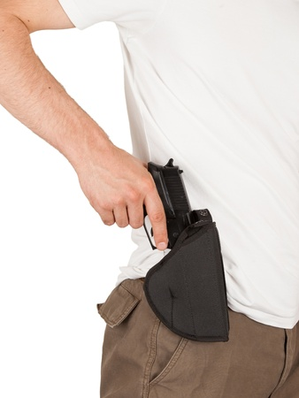 lawman: Close-up of a man with his hand on a gun, isolated on white