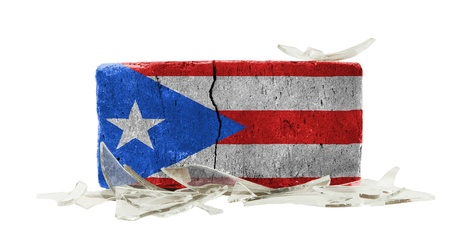 puerto rican flag: Brick with broken glass, violence concept, flag of Puerto Rico Stock Photo