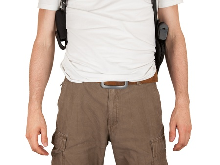 sidearm: Close-up of a man with holster and a gun, isolated on white Stock Photo