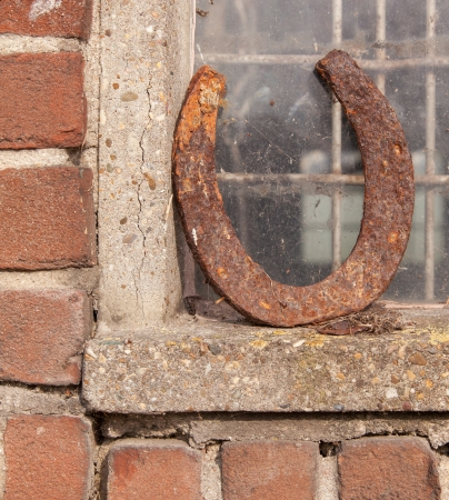 Single horseshoe in front of a window, bringing luck photo