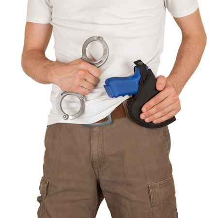 law enforcer: Close-up of a man with holster and a blue training gun, isolated on white Stock Photo
