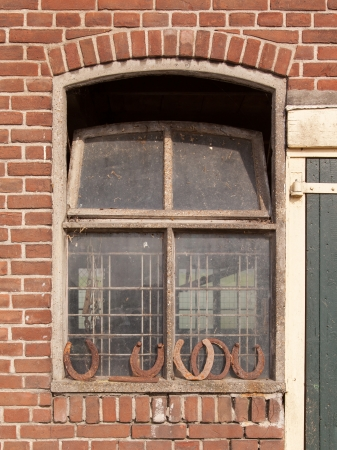 Horseshoes in front of a window, bringing luck photo