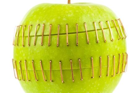 sliced apple: Sliced apple halves joined by brass staples