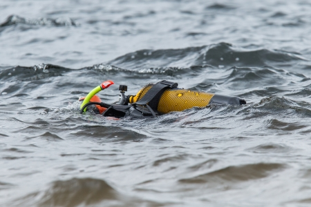 padi: Close-up of the gear of a scuba-diver