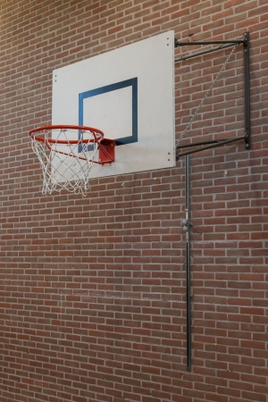 Basketball hoop on an oldbrick wall, gym photo