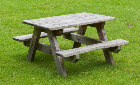 Small wooden picknickplace on a green field Stock Photo - 21302057
