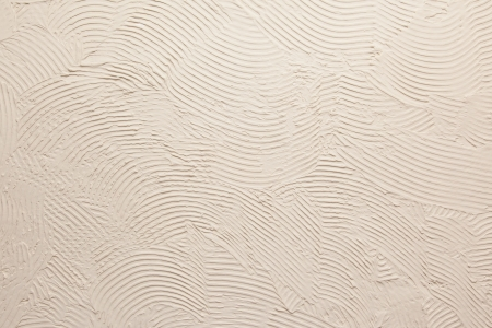 Close up of an old grey stucco wall Archivio Fotografico