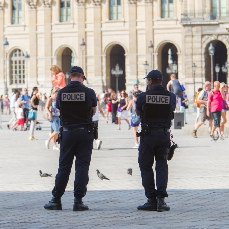 syndicate: PARIS, FRANCE - July 28 2013: French police control the street at the Louvre during one of the busiest days of the year, Paris the 28 of July 2013, France Editorial