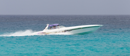 inhabitants: ST MARTIN - ANTILLES, JULY 19, 2013 - Speedboat with tourist on the Caribbean sea on July 19, 2013. Nearly 500.000 tourists visit St Martin every year, much for a isle with 75.000 inhabitants. ST MARTIN, July 19, 2013 Editorial