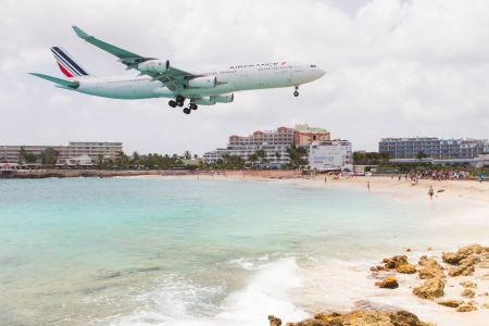 ST MARTIN, ANTILLES - July 19: the tourist office and Air France signs an agreement to strengthen their partnership (joint communication plan). Daily A340 about to touch down in July 19. 2013 at SXM.