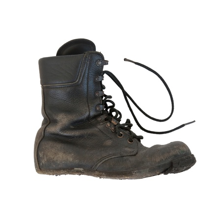 Army boot isolated on white, sole almost completely gone photo