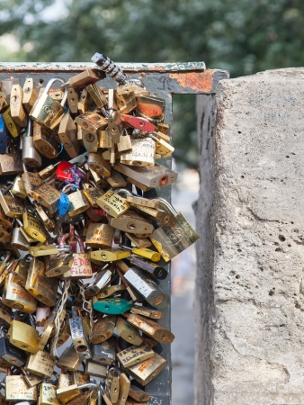 PARIS - JULY 27: Lockers at Pont des Arts symbolize love for ever, July 27, 2013 in Paris. 16000 lockers of loving couples are on that bridge, also known as Passarelle des Arts
