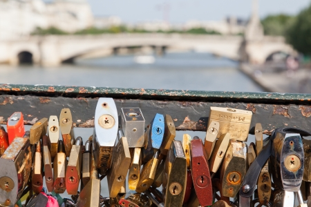 amorousness: PARIS - JULY 27: Lockers at Pont des Arts symbolize love for ever, July 27, 2013 in Paris. 16000 lockers of loving couples are on that bridge, also known as Passarelle des Arts