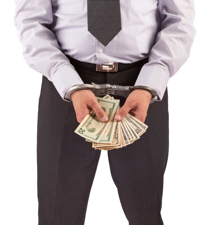 Business man in handcuffs arrested for bribe, isolated on white photo
