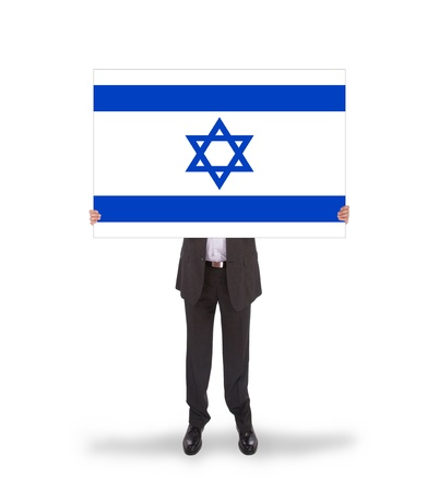 Smiling businessman holding a big card, flag of Israel, isolated on white photo