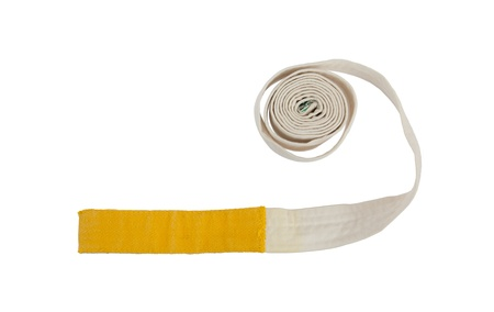 krav maga: White and yellow belt isolated on a white background Stock Photo