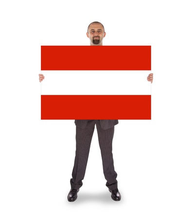 Smiling businessman holding a big card, flag of Austria, isolated on white photo