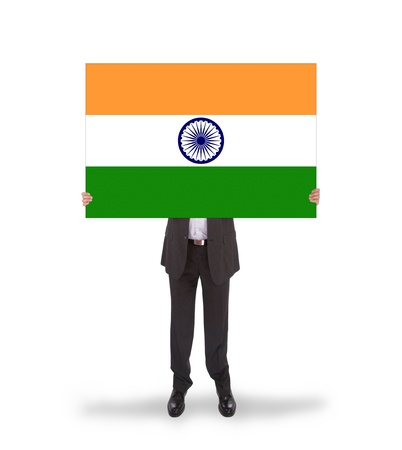 Businessman holding a big card, flag of India, isolated on white photo