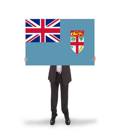 fiji: Businessman holding a big card, flag of Fiji, isolated on white