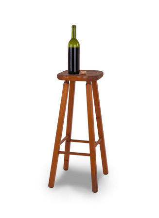 Old stool and bottle of wine isolated on white background photo