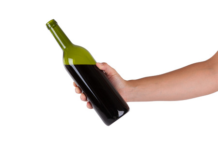 white wine bottle: Hand holding a bottle of red wine isolated on white