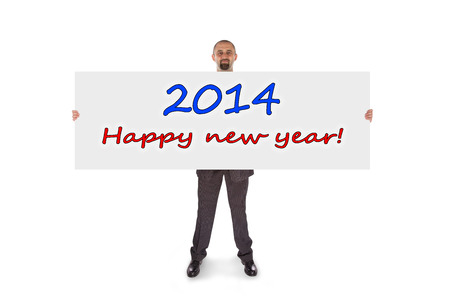 Smiling businessman holding a really big card, isolated on white, happy new year photo