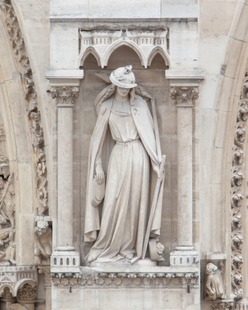Architectural details of Cathedral Notre Dame de Paris who is the most famous Gothic, Roman Catholic cathedral (1163-1345) photo