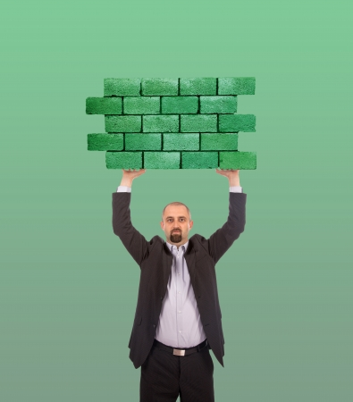 lybia: Businessman holding a large piece of a brick wall, flag of Lybia, isolated on national flag