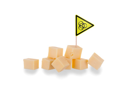 Pieces of cheese isolated on a white background, biohazard warning photo