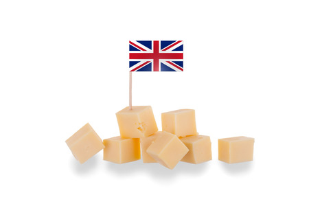 Pieces of cheese isolated on a white background, flag of the United Kingdom photo