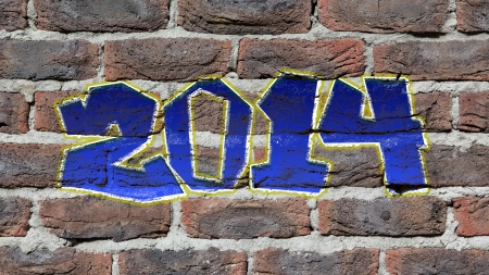 Old dark red brick wall texture with graffity, 2014 photo