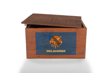 Wooden crate isolated on a white background, product of Oklahoma photo